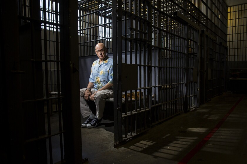 Author James Ellroy inside a replica jail cell at the Los Angeles Police Museum.