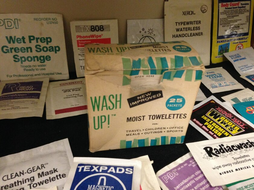"This Nov. 26, 2014 photo shows a box of ""Wash Up!"" moist towelettes, the oldest artifact at the Moist Towelette Museum in East Lansing, Mich. The museum on the campus of Michigan State University includes more than a thousand, mostly unused, wet wipes from around the world. (AP Photo/David Eggert)"