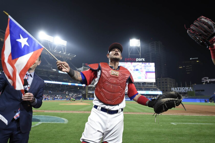 Yadier Molina, #4 of Puerto Rico, celebrates after Puerto Rico beat the Dominican Republic 3-1 in the World Baseball Classic Pool F Game One at PETCO Park on March 14, 2017 in San Diego. (Denis Poroy/Getty Images)