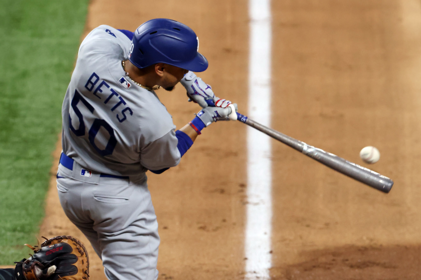 Dodgers right fielder Mookie Betts hits a double against the San Diego Padres in Game 3 of the NLDS.