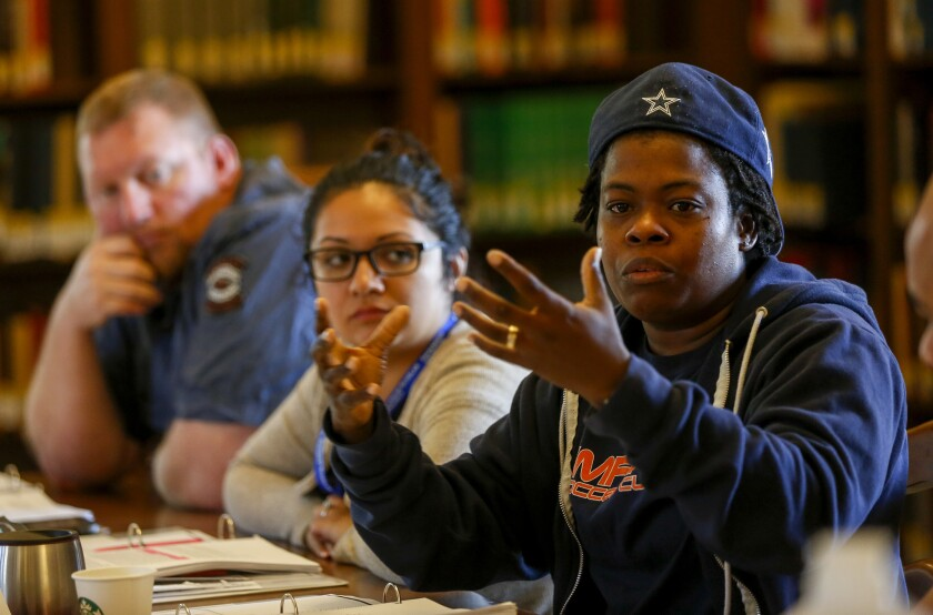 From left, Jacob Wessel and Carmen Molina listen to fellow veteran Charena Lafayette during a group discussion in the Warrior-Scholar Project at USC. The program prepares veterans for higher education.