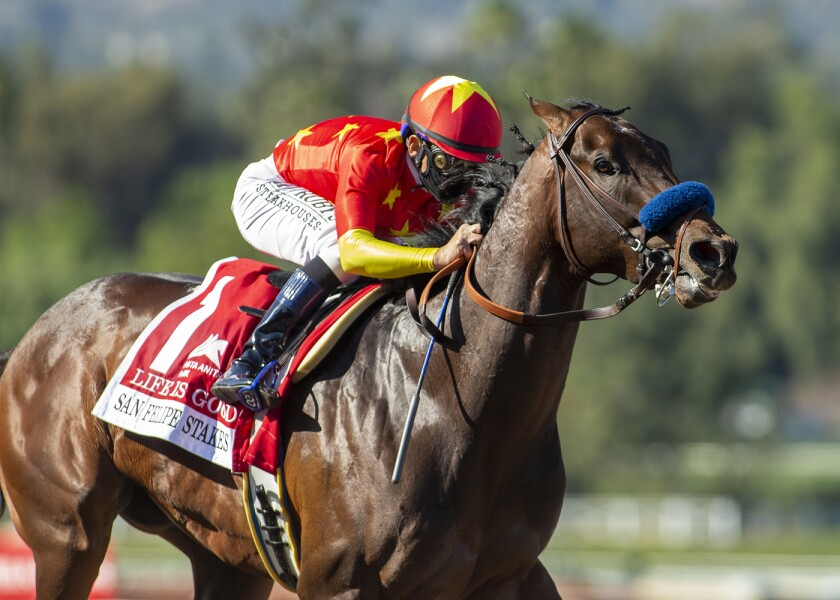 Life Is Good and jockey Mike Smith win the $300,000 San Felipe Stakes on March 6, 2021, at Santa Anita Park.
