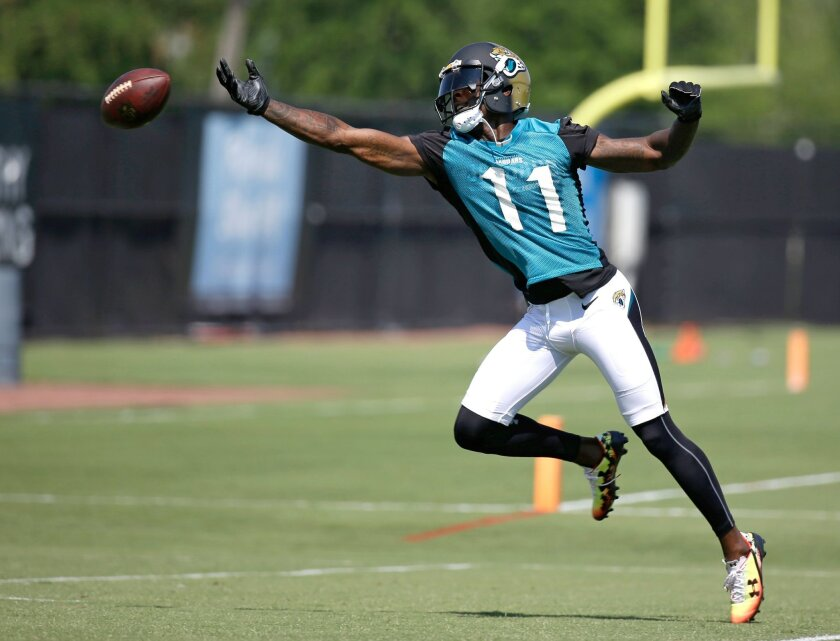 Jacksonville Jaguars wide receiver Marqise Lee (11) reaches for an overthrown pass during NFL football practice, Tuesday, May 24, 2016, in Jacksonville, Fla. (AP Photo/John Raoux)