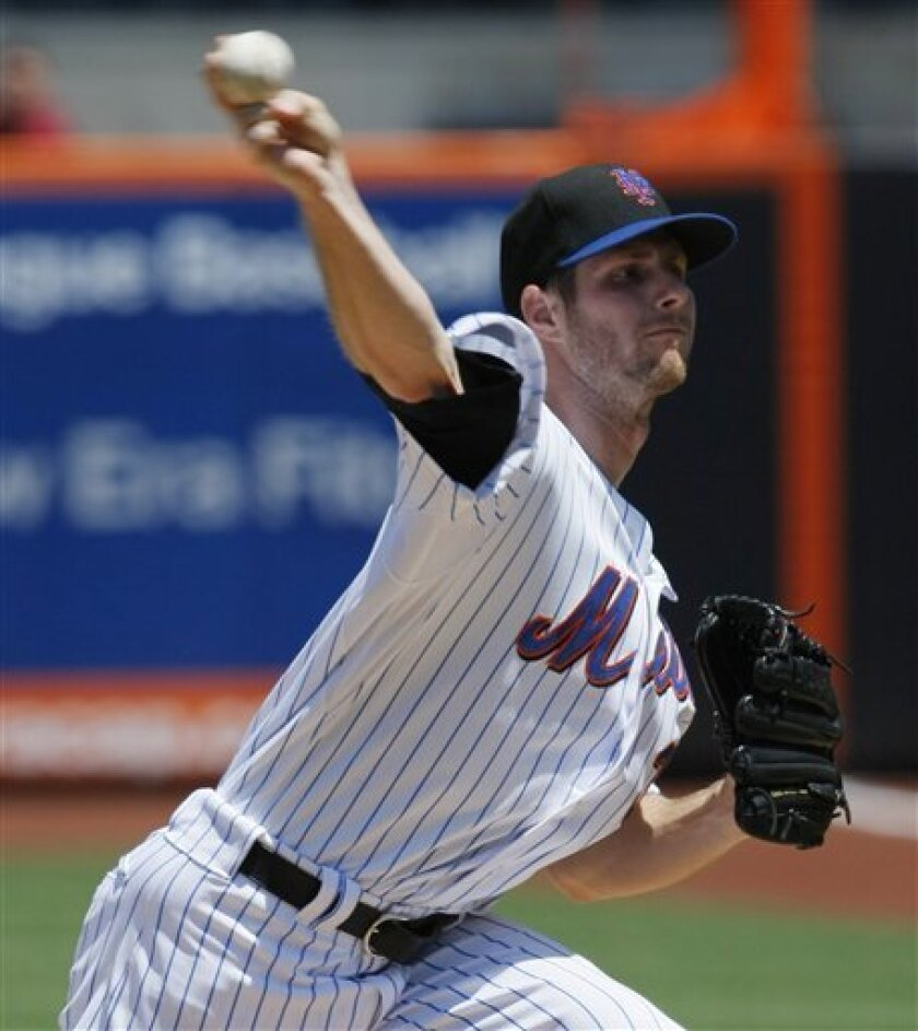 New York Mets pitcher John Maine delivers in the first inning against the Florida Marlins in their baseball game at Citi Field in New York, Sunday, May 31, 2009. (AP Photo/Kathy Willens)