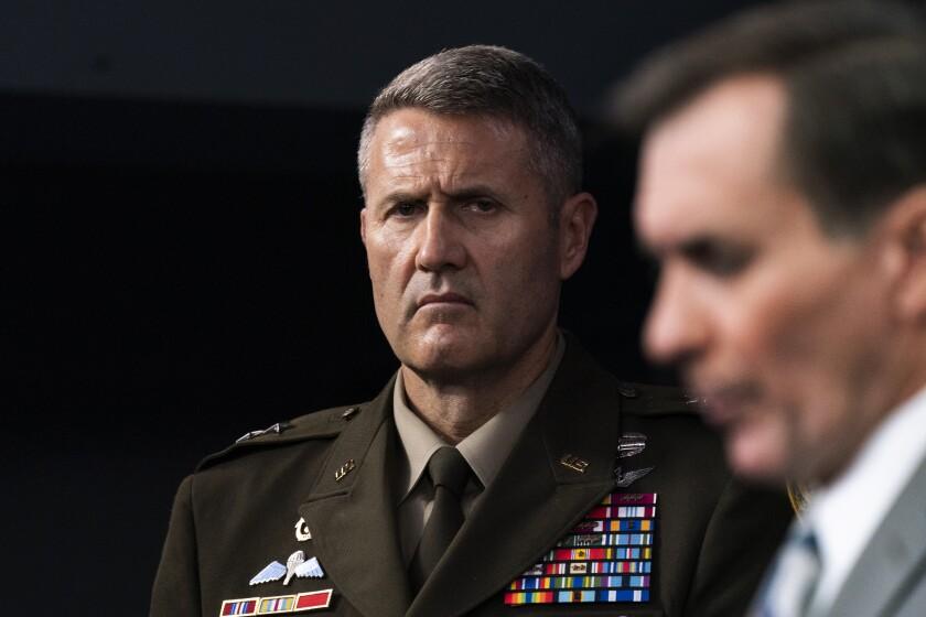 Army Maj. Gen. William Taylor listens as  John Kirby speaks