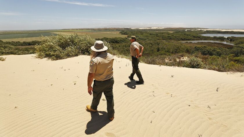 OCEANO, CA - JULY 03, 2019 - Ronnie Glick, left, a senior environmental scientist for the state park