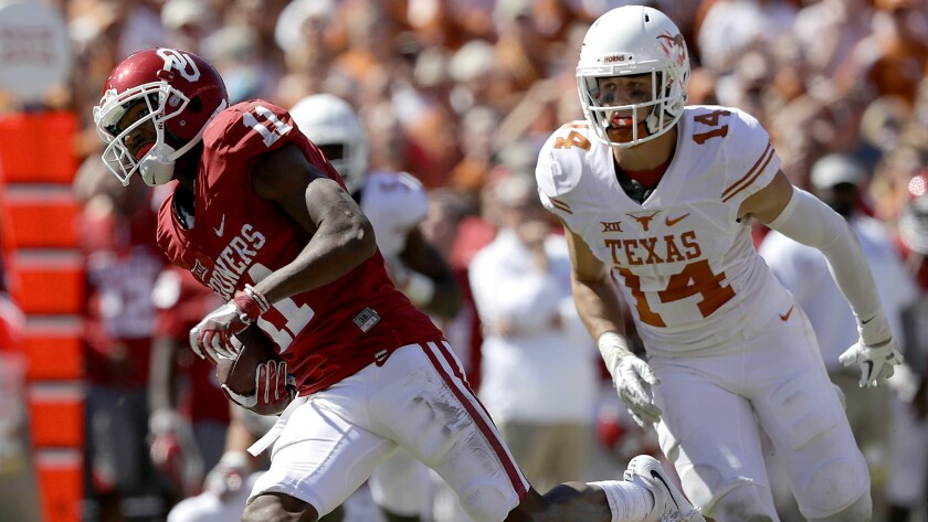 Oklahoma receiver Dede Westbrook breaks into the clear on one of his three touchdown receptions against Texas on Saturday.