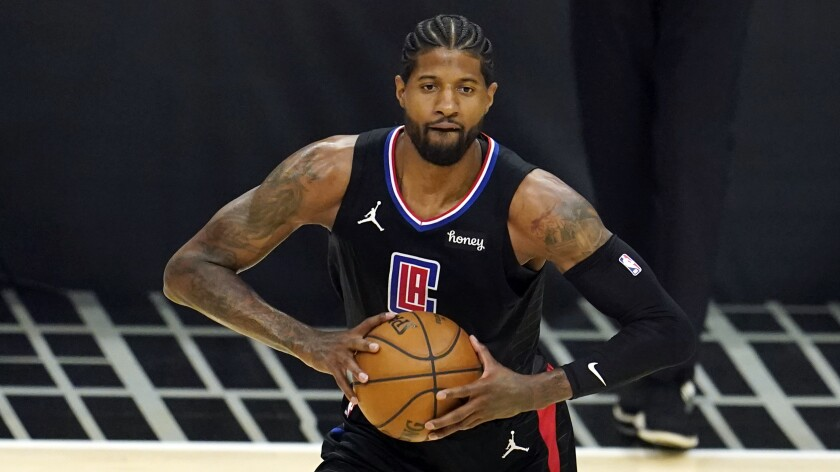 Los Angeles Clippers guard Paul George passes the ball
