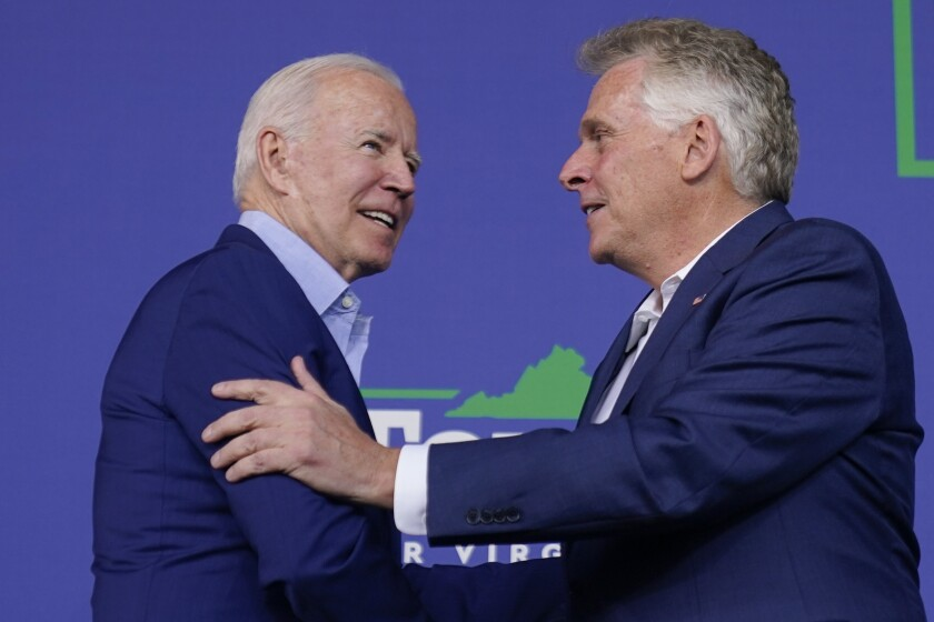 President Joe Biden greets Virginia democratic gubernatorial candidate Terry McAuliffe as he arrives to speak at a campaign event for McAuliffe at Lubber Run Park, Friday, July 23, 2021, in Arlington, Va. (AP Photo/Andrew Harnik)