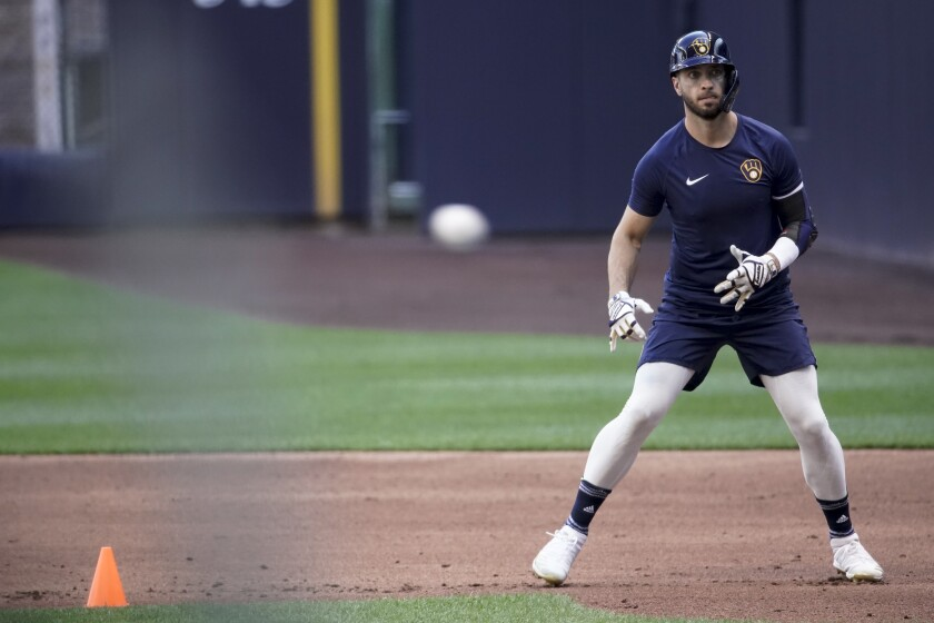 Milwaukee Brewers' Ryan Braun runs during a practice session Saturday, July 4, 2020, at Miller Park in Milwaukee. (AP Photo/Morry Gash)