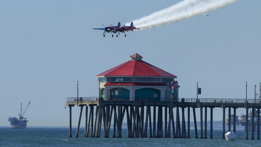 Jeff Boerboon flying a Yak-110 passes over the Huntington Beach Pier during day one of The Great Pac