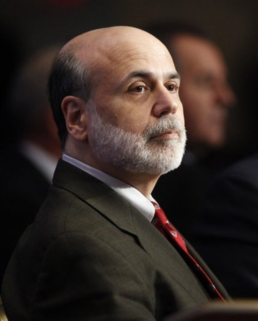 FILE -- In a Dec. 7, 2009 file photo Federal Reserve Chairman Ben Bernanke waits to speak during a discussion hosted by The Economic Club of Washington, in Washington. The Senate has confirmed Bernanke for a second term as chairman of the Federal Reserve. (AP Photo/Haraz Ghanbari/File)