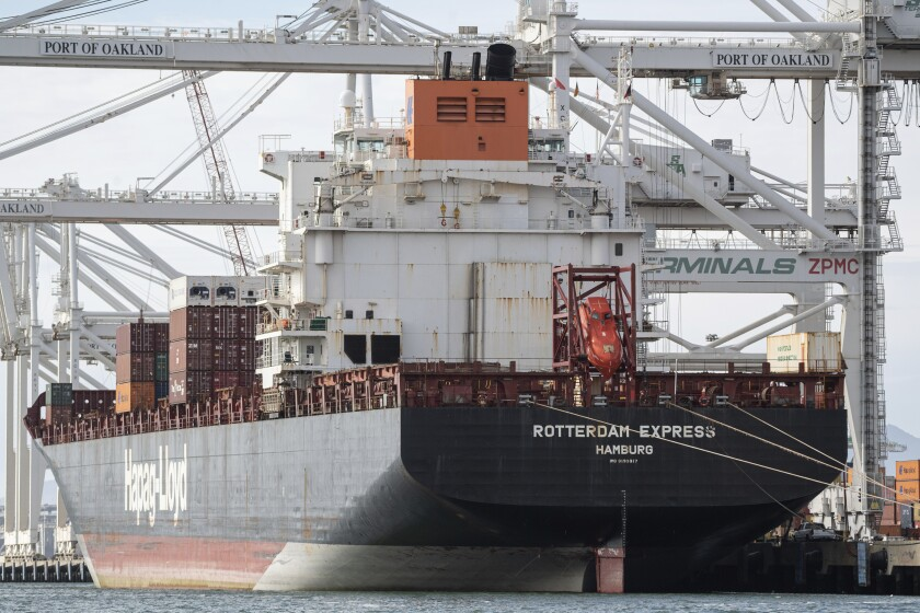 A cargo ship sits at port in Oakland.