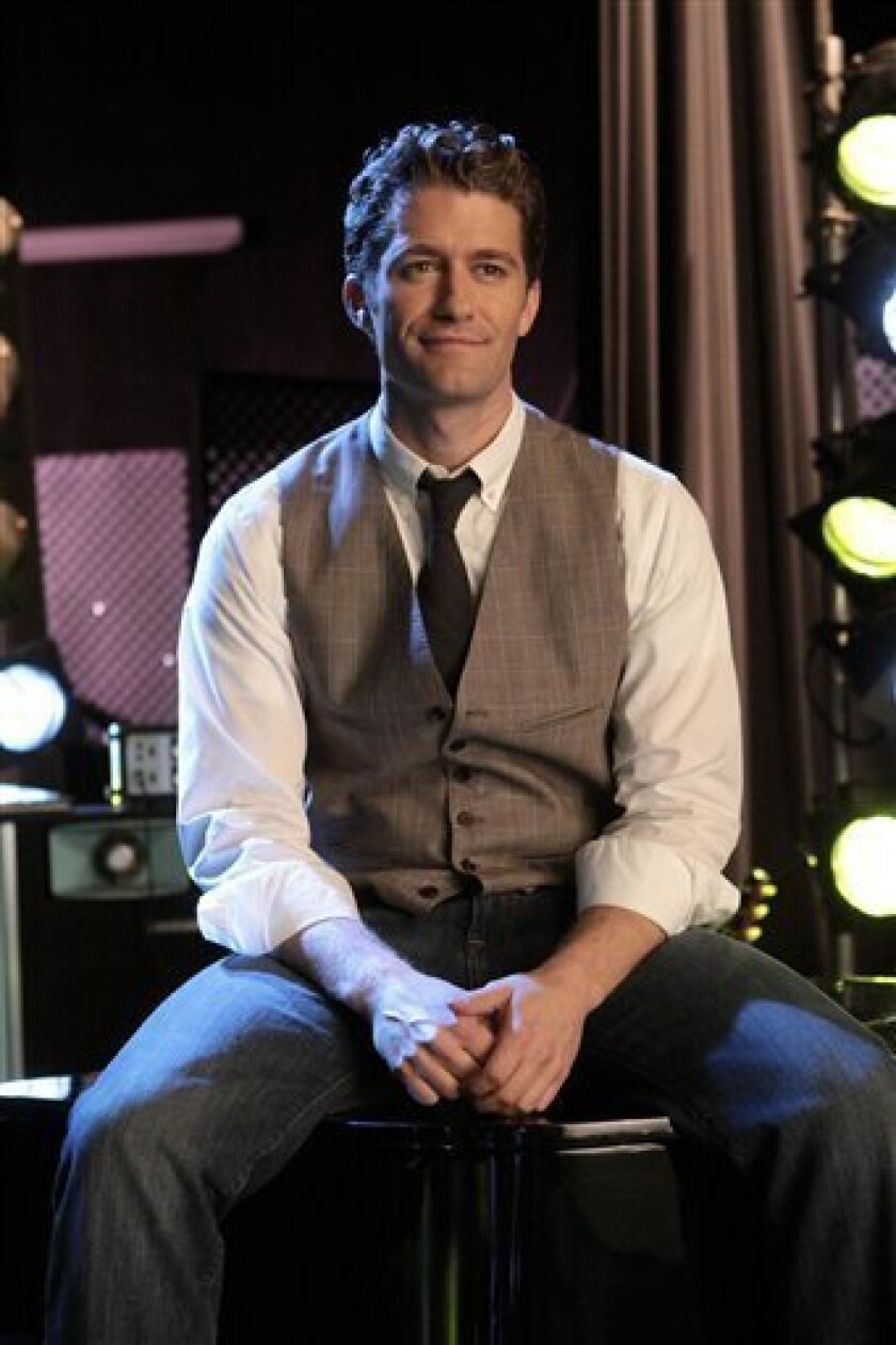 "In this publicity image released by Fox, Matthew Morrison is shown in a scene from, ""Glee."" (AP Photo/Fox, Carin Baer)"