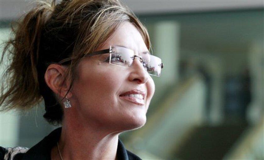 Former Alaska Gov. Sarah Palin exits the Hyatt Regency Hotel, Wednesday, June 1, 2011 in Jersey City, N.J. (AP Photo/Julio Cortez)