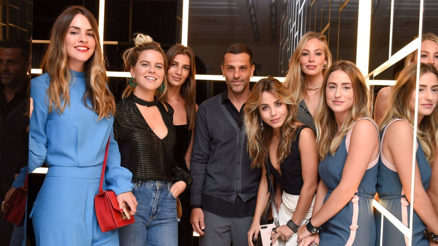 Alexandre Birman, seen in the center among party attendees, is the founder of Schutz.