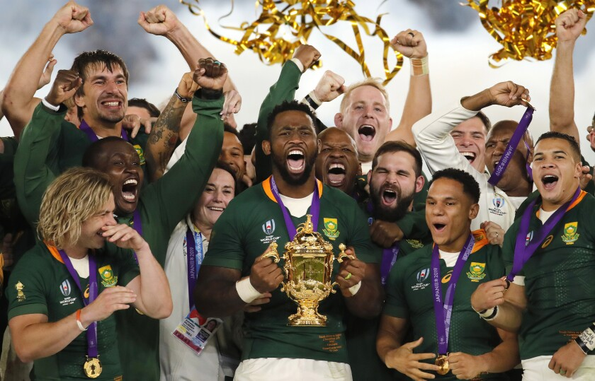 FILE - In this Saturday, Nov. 2, 2019 file photo, South African captain Siya Kolisi holds the Webb Ellis Cup after South Africa defeated England to win the Rugby World Cup final at International Yokohama Stadium in Yokohama, Japan. South Africa's Rugby World Cup-winning captain Siya Kolisi and his wife, Rachel, have fast-tracked the launch of their foundation to help the country's hospitals during the coronavirus pandemic. (AP Photo/Christophe Ena, File)