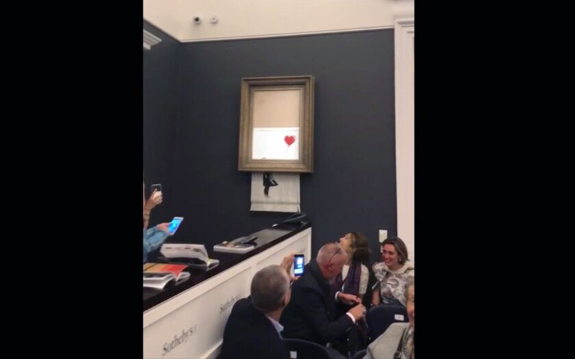 """Banksy's painting """"Girl with the Balloon"""" was shredded moments after selling for over $1 million."""