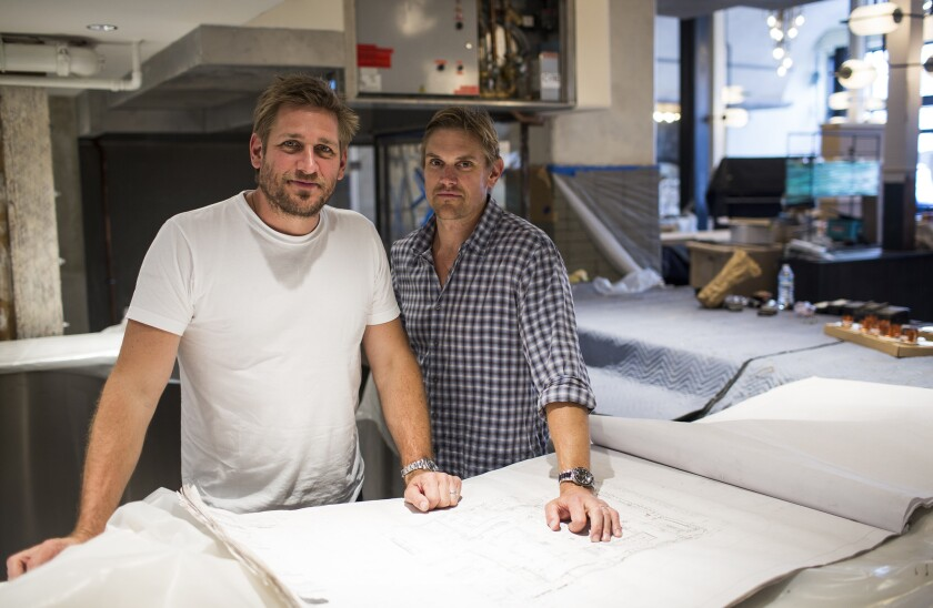 Australian Chef Curtis Stone, left, and his brother Luke Stone are seen at Gwen during construction.