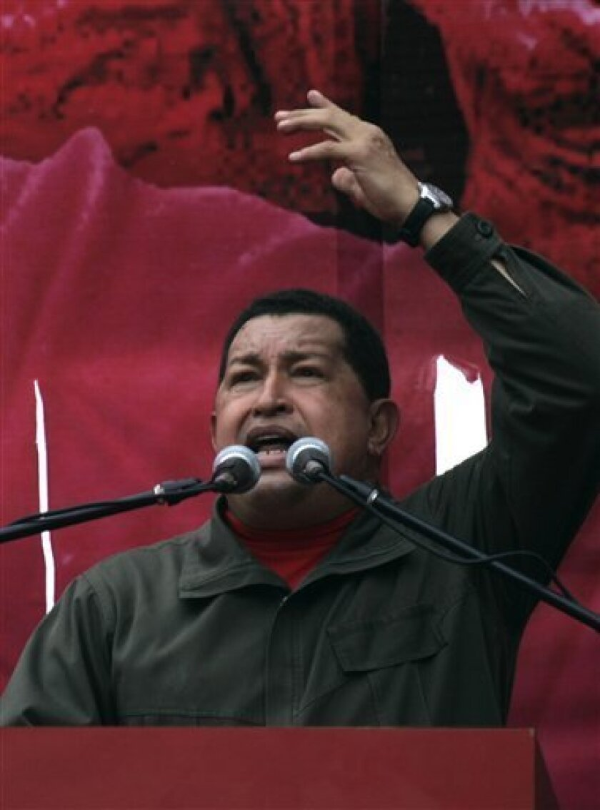 Venezuela's President Hugo Chavez gestures as he delivers a seech during Labor Day in Caracas, Friday, May 1, 2009. (AP Photo/Fernando Llano)