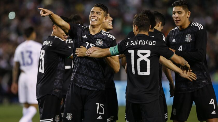 Mexico's Hector Moreno (15), pointing, celebrates his second half goal against Chile with teammates.