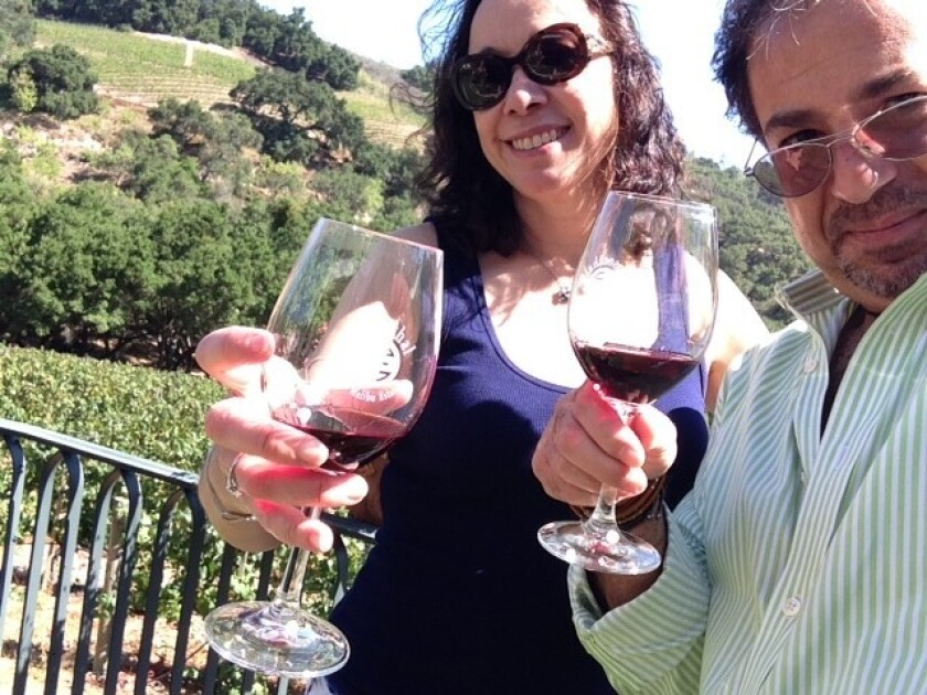 The author and a friend, both single, take in a wine-tasting in Malibu this past summer.
