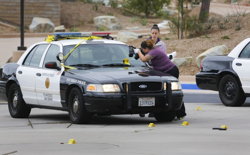 San Diego Police collect evidence at the scene of a fatal officer-involved shooting at Torrey Pines High School in 2017.