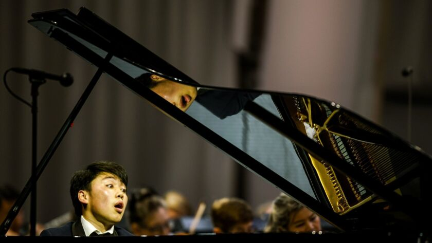 LOS ANGLELES, CALIF. - JULY 26: Pianist George Li performs Edvard Greig's Piano Concerto in A minor,