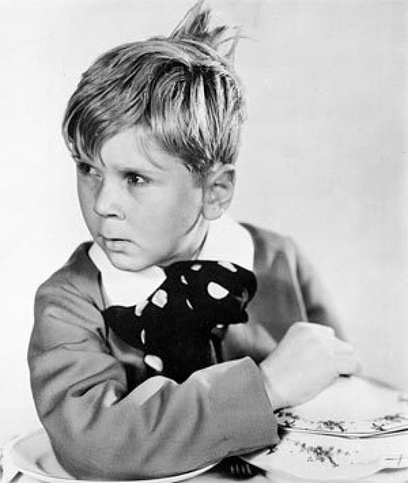 "Jackie Cooper is shown in costume for his role in the 1931 Hollywood movie ""Skippy."" Cooper earned a best actor nomination for the role, making him the youngest actor to be nominated for an Academy Award."