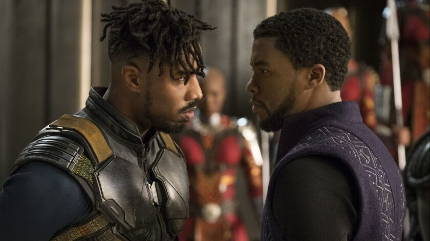 This image released by Disney shows Michael B. Jordan, left, and Chadwick Boseman in a scene from Ma