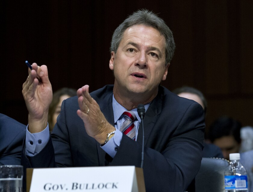 In this Sept. 7, 2017 file photo, Montana Governor Steve Bullock speaks before a U.S. Senate committee Capitol Hill in Washington. The Democrat signed an executive order Monday prohibiting telecommunications companies from receiving state contracts if they interfere with internet traffic or favor higher-paying sites or apps.