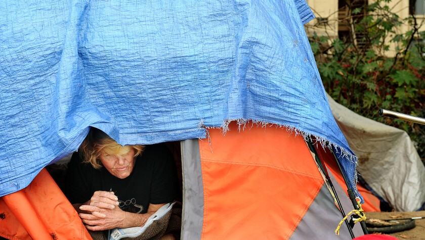 FOUNTAIN VALLEY-CA-NOVEMBER 1, 2017: Nancy Gardner sits inside her tent on November 1. Officials ann