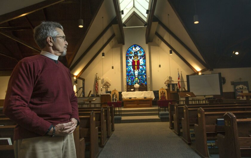 Rev. Tom Morelli in the sanctuary of St. Anne's Episcopal Church in Oceanside Wednesday. photo by Bill Wechter