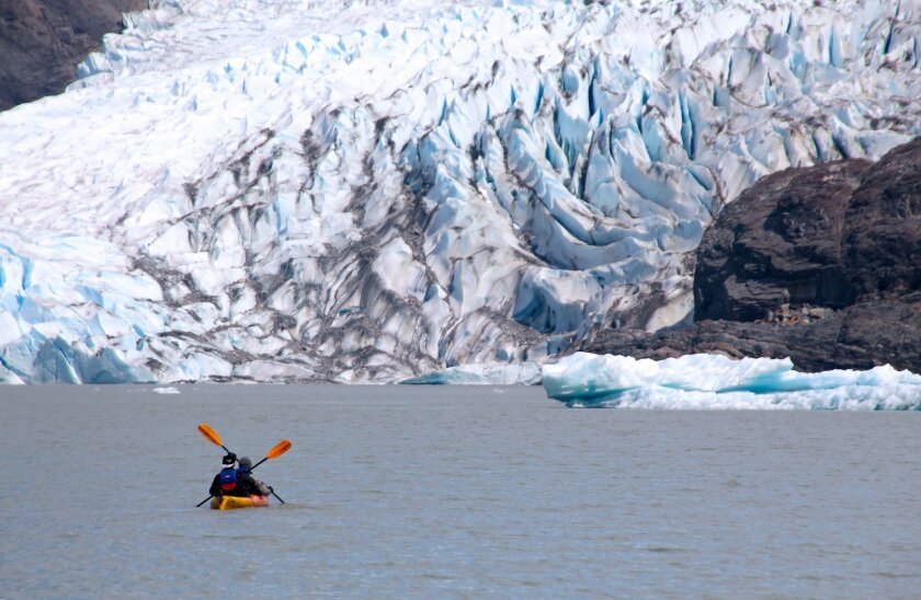 """The Mendenhall Glacier is considered one of the world's few """"urban"""" glaciers, located less than a half-hour drive from Juneau."""