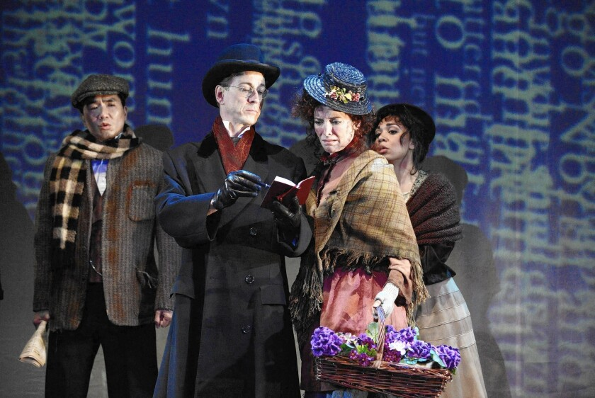 Bruce Turk and Paige Lindsey White, foreground, are Henry Higgins and Eliza Doolittle, with Greg Wantanabe and Sarah Hollis in background.