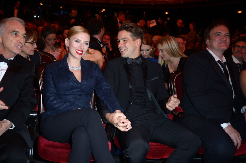 Actress Scarlett Johansson reportedly weds Romain Dauriac in secret.