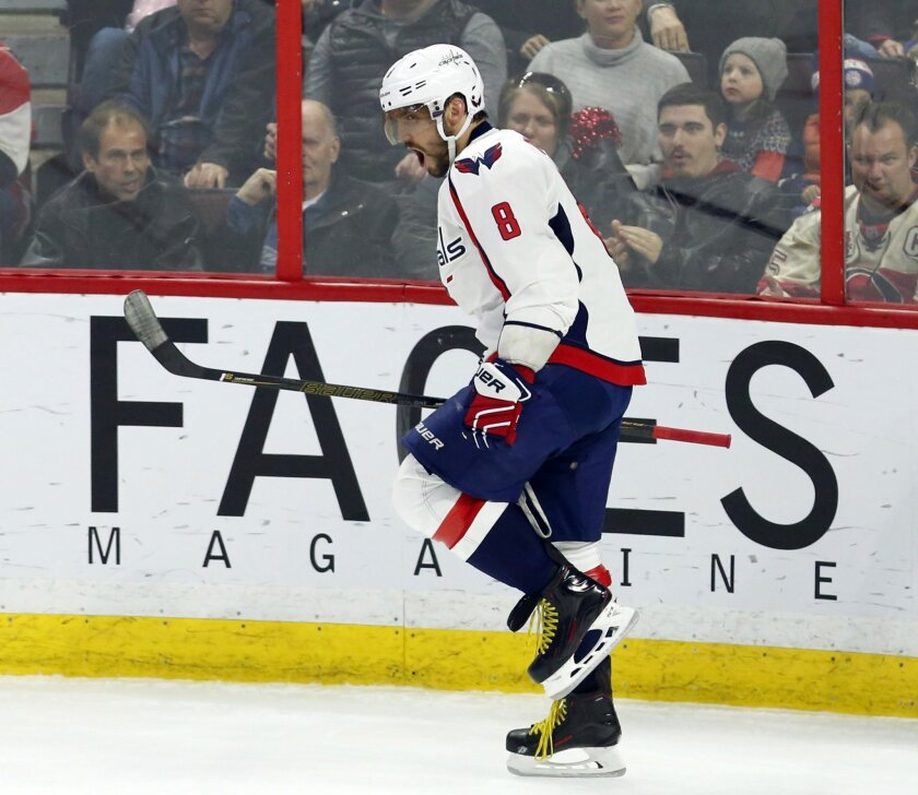 Washington Capitals' Alex Ovechkin (8) celebrates his goal against the Ottawa Senators during the first period of an NHL hockey game, Tuesday, March 22, 2016 in Ottawa, Ontario. (Fred Chartrand/The Canadian Press via AP) MANDATORY CREDIT