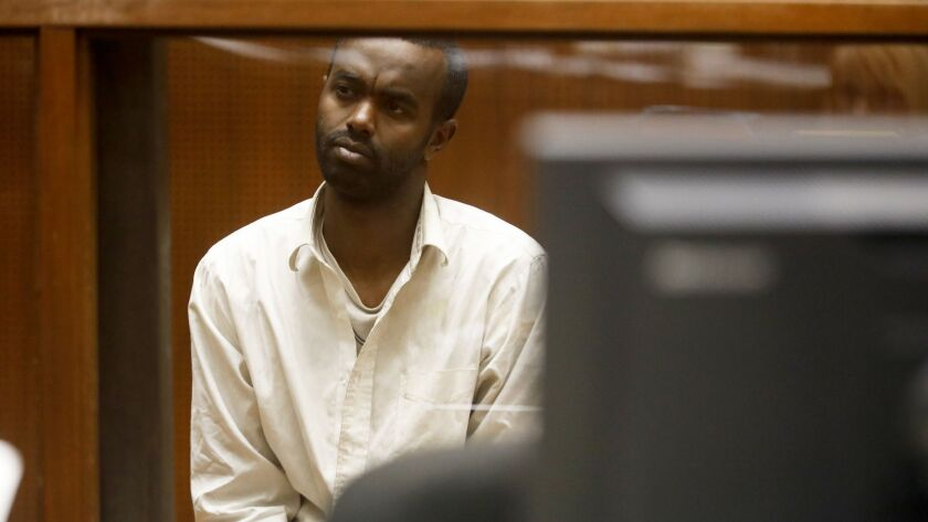 Mohamed Abdi Mohamed appears in a downtown L.A. courthouse. He is accused of trying to run over two men near a Los Angeles synagogue and has been charged with two counts of assault with a deadly weapon.