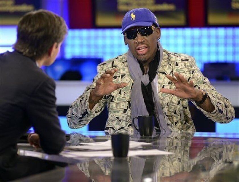 """In this photo made available by ABC Television on Monday, March 4, 2013, ABC's """"This Week"""" host George Stephanopoulos, left, interviews former NBA star Dennis Rodman in studio in New York March 3, 2013, about his visit with North Korean leader Kim Jong Un. In response to Rodman's comments White Hou"""