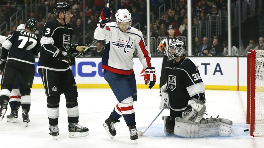 Washington's Lars Eller reacts after a teammate scored against goalie Jack Campbell and the Kings on Monday night.