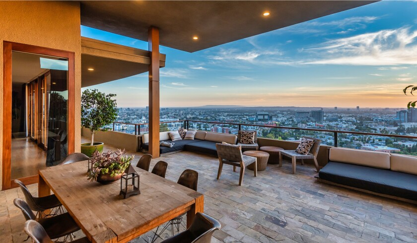 The hillside home includes three levels of decks, balconies and patios, as well as a swimming pool and spa.