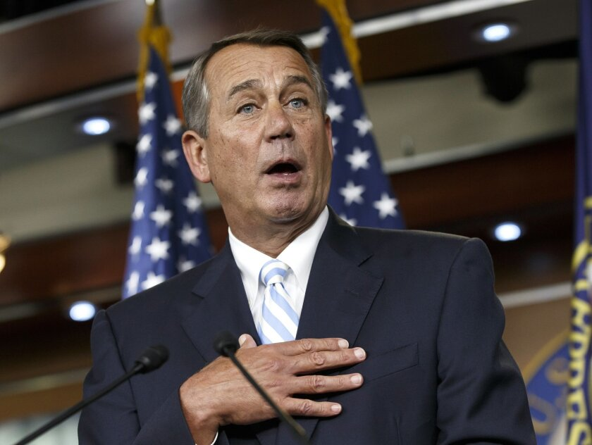 House Speaker John Boehner of Ohio defends the work of the GOP during a brief news conference on Capitol Hill in Washington, Thursday, July 31, 2014, as Congress prepares to leave for a five-week summer recess. The institutional split of a Republican-led House and Democratic-controlled Senate has a