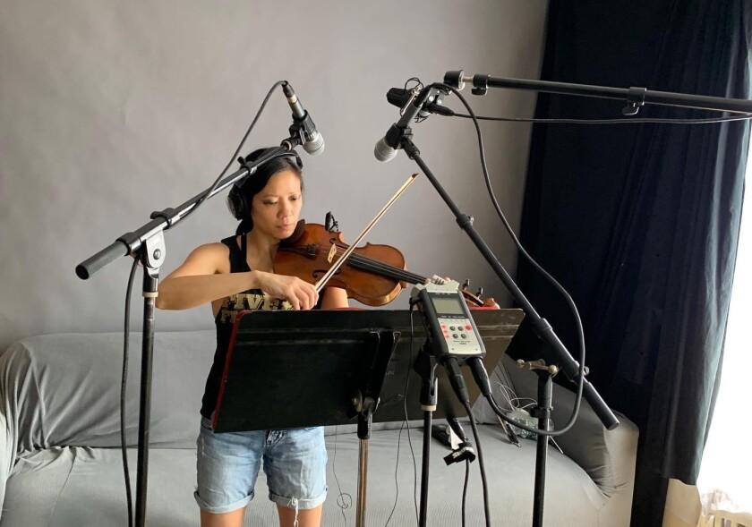 Violinist Melissa Tong recording music at home.
