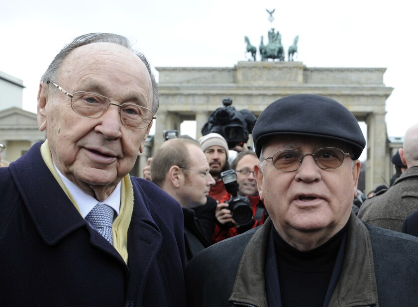Former West German Foreign Minister Hans-Dietrich Genscher, left, with former Soviet leader Mikhail S. Gorbachev at the Brandenburg Gate in Berlin in 2009, two decades after the fall of the Berlin Wall.