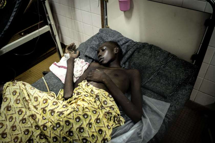 A wounded boy rests in hospital after rebels stormed a church compound where hundreds of civilians had sought refuge in the Central African Republic capital, Bangui, on May 28.