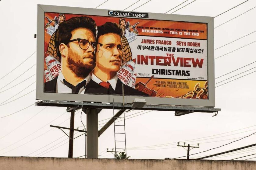 """A billboard for the film """"The Interview"""" is displayed December 19, 2014 in Venice, California. Sony has canceled the release of the film after a hacking scandal that exposed sensitive internal Sony communications."""