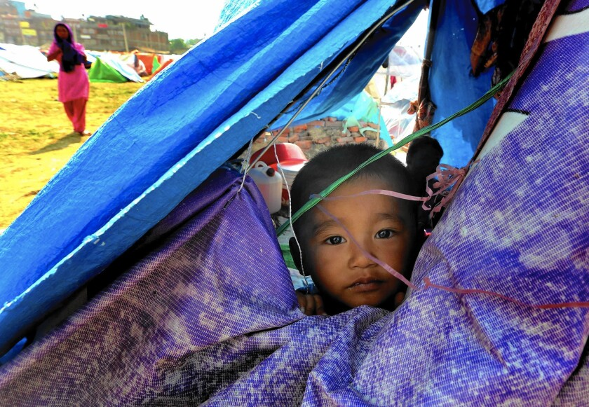 """""""Children are very resilient,"""" says Ramsey Ben-Achour, a UNICEF child protection specialist. Above, a temporary shelter near Katmandu, Nepal."""