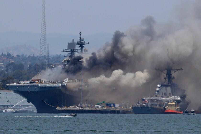 A fire burns on the amphibious assault ship Bonhomme Richard