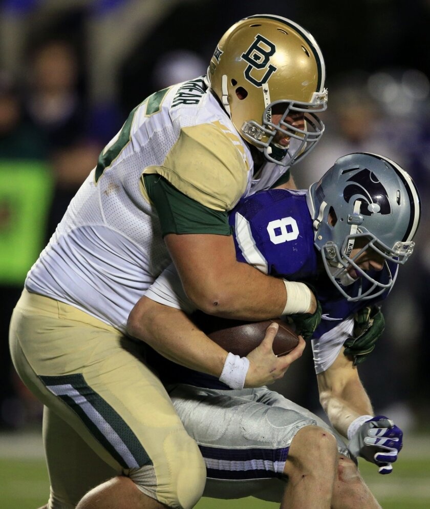 Baylor defensive lineman Beau Blackshear (95) sacks Kansas State quarterback Joe Hubener (8) during the second half of an NCAA college football game in Manhattan, Kan., Thursday, Nov. 5, 2015. Baylor defeated Kansas State 31-24. (AP Photo/Orlin Wagner)