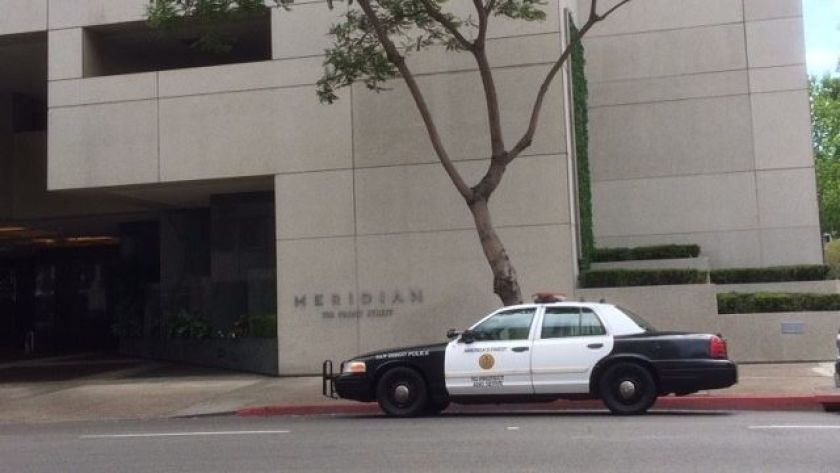 A San Diego Police Department patrol car is parked outside the Meridian condos on Saturday, June 30, 2018, after a woman died at the complex.